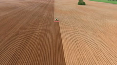 Farmer seeding, sowing crops at field.Aerial view Stock Footage