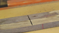 Carpenter renovates a wooden plank with electrical plane Stock Footage