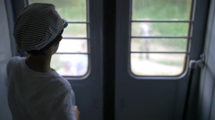 Boy traveling by train, slow motion Stock Footage