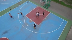 Overhead aerial shot of asian men trying to put the ball through the basket Stock Footage