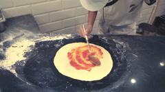 Chef preparing pizza in kitchen Stock Footage