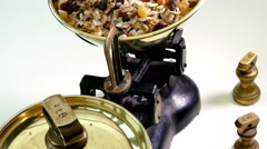 Muesli being weighed on traditional scales. Stock Footage