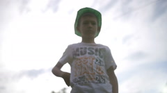 Boy pulls out a gun and shoots at the camera, gangster, slow motion Arkistovideo