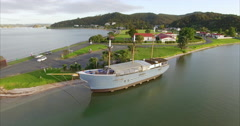 Aerial over an old sailing ship in Paihia, Northland, New Zealand Stock Footage