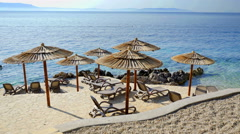 Beautiful thatched umbrellas on the beach  Stock Footage