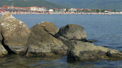 Crowd of people having  fun on sea holiday at summer season by Sheyno. Stock Footage