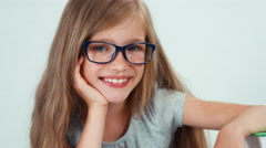 Extreme close up portrait student girl with long blond hair 7-8 years in glasses Stock Footage