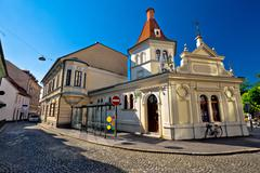 Ljubljana cobbled old street and architecture view - stock photo