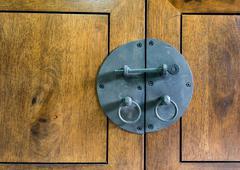 Close up - Vintage black Latch on wood Stock Photos