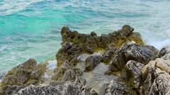 Rocks in the sea and foam Stock Footage