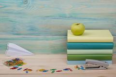 Back to school. Stack of colorful books on wooden table. Copy space Stock Photos