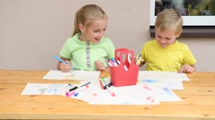 kids painting with pencils - stock footage