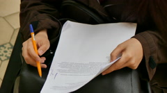 Girl taking notes pen paper Stock Footage