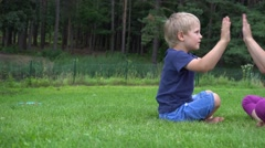 Children playing on the grass Stock Footage