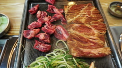 Traditional Korean food, barbecue and side dishes vegetable - stock footage