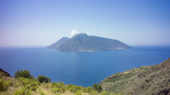 View of Mediterranean island with boats on a clear day in summer, 4K time lapse Stock Footage