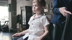 Little Client in Barbershop Stock Footage