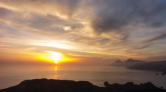 Spectacular sunset behind an island in the Mediterranean sea, 4K time lapse Stock Footage