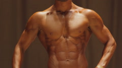 Perfect strong masculine body, male bodybuilder boasting of muscular physique - stock footage