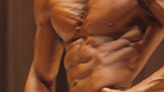 Closeup of muscular male torso, man showing body exhausted by excessive workouts - stock footage