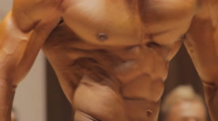 Close-up of tense male torso muscles, bodybuilder physique, perfect six-pack abs - stock footage