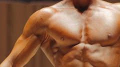 Muscular torso of healthy strong man and bodybuilder's exhausted body, contrast Stock Footage