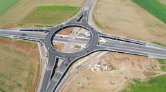 Suspended roundabout, aerial overfly - stock footage