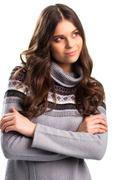 Woman in pullover slightly smiling. Stock Photos