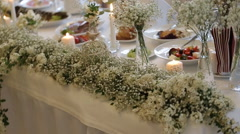 Flower decorations on the wedding tables Stock Footage