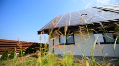 Modern home with solar and thermal renewable energy panels on the roof Stock Footage