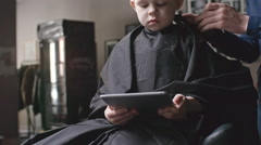 Barber Giving Haircut to Little Boy Stock Footage