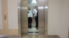 Five workers in the elevator Stock Footage