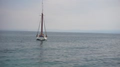 Sailing boat on garda lake near bardolino Stock Footage
