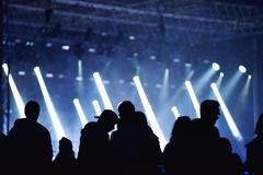 Stage lights. Concert scene with crowd in foreground Stock Photos