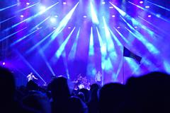 Crowd at a live concert with stage lights in the background Stock Photos