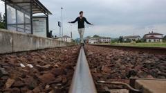 Men walking on rail in equilibrium Stock Footage