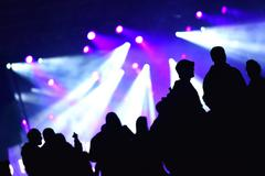 Stage lights. Concert scene with crowd the foreground Stock Photos