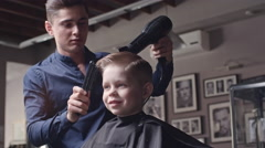 Kid Enjoying New Hairstyle - stock footage