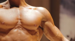 Handsome self-confident man showing muscular chest and strong arms, bodybuilding Stock Footage