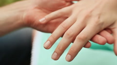 A man puts a ring on the finger of a woman Stock Footage