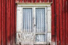 Weathered door of an old Swedish farmhouse - stock photo