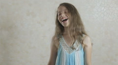 Beautiful girl rejoices donated bouquet of flowers and swirls Stock Footage