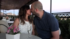 Perfect young couple kissing with passion and loving outdoor at bar cafe love 4K - stock footage
