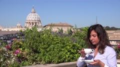 Beautiful girl on terrace rooftop morning coffee time enjoy Rome Vatican city 4K - stock footage