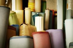Rolls of materials, fabric and leather used in book binding. Stock Photos