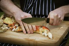 Close up of a chef preparing a crab. Stock Photos