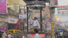 Traffic police controlling traffic in old town,Allahabad,India Stock Footage