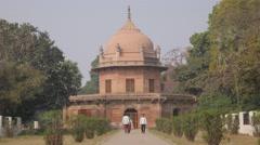 People walking at Tamolon tomb,Allahabad,Khusru Bagh,India Stock Footage