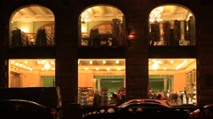 customers in the stores of the Singer House in Saint Petersburg at night - stock footage