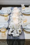 Place settings at a table dressed for an occasion. Kuvituskuvat